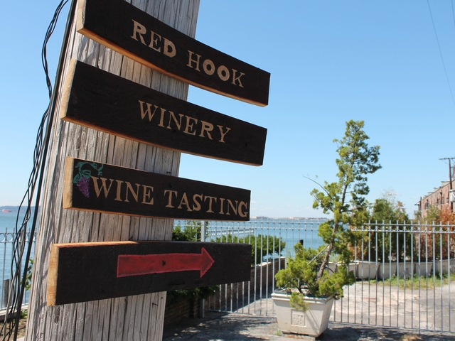 A sign points the way to the Red Hook Winery on Brooklyn's waterfront, the only winery listed on the Brooklyn Spirits Trail.