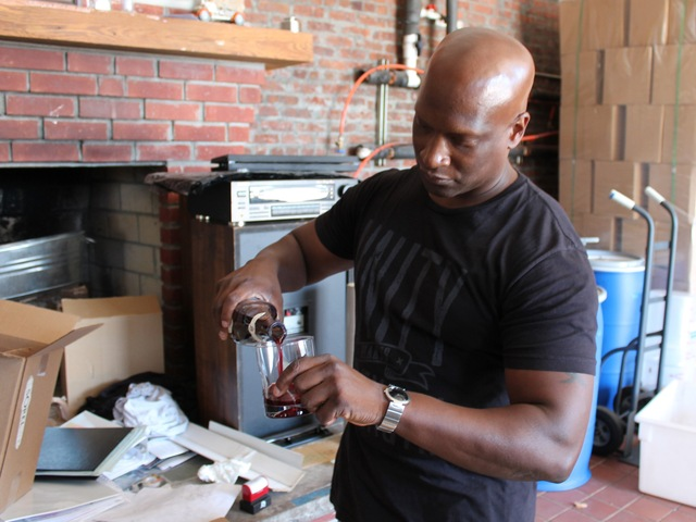 Jackie Summers, co-founder and co-owner of Jack from Brooklyn in Red Hook, pours a glass of Sorel, which scored a 91 from 'Wine Enthusiast.'