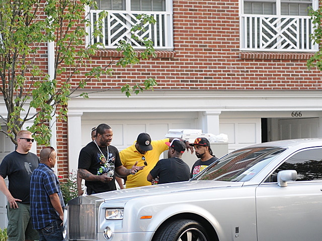 Busta Rhymes, in black T-shirt and chain, outside the home of hip-hop executive Chris Lighty, who was found dead of an apparent suicide on Aug. 30, 2012.