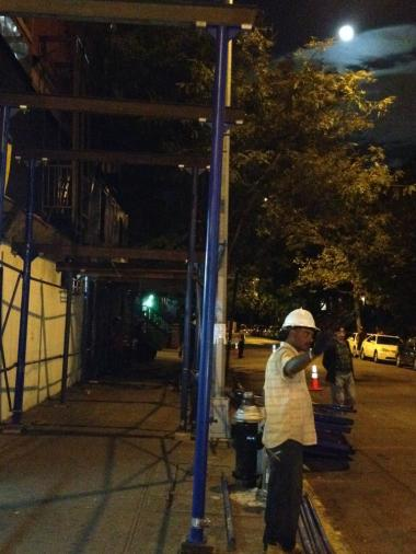 A worker presides over the re-instillation of a troublesome scaffolding at Lenox Avenue and 123rd Street in Harlem.