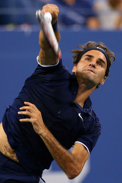 Roger Federer playing at the USTA National Tennis Center in Flushing, Queens, Thursday, August 30, 2012.