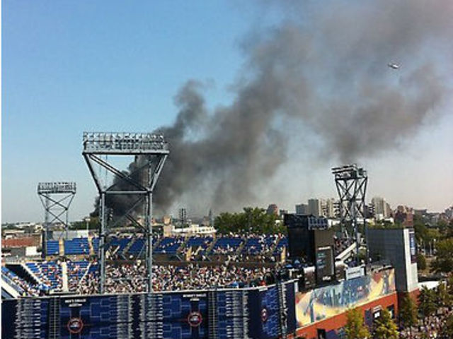 The fire, which broke out nearby around 11:30 in the morning, didn't disrupt the matches on Friday August 31, 2012.