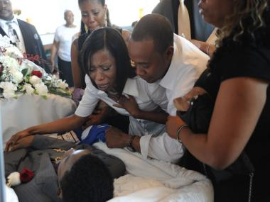 Family and friends mourn the death of Ronald Wallace, a 13-year-old who was fatally shot in Brownsville August 24.