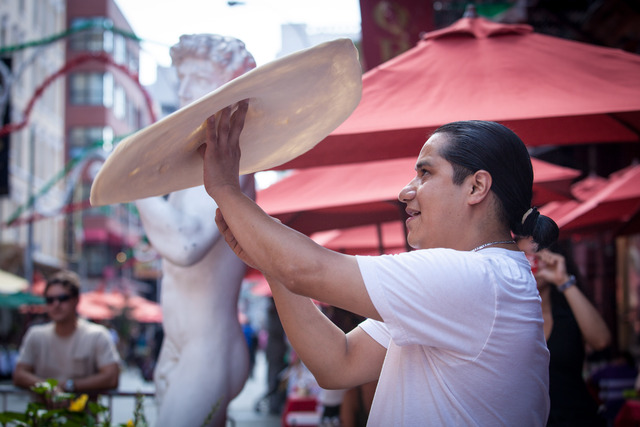 Oscar Hernandez, 34, the pizza tosser from Il Piccolo Bufalo, performs the pizza throwing in Mulberry St.