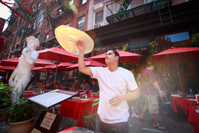 The performance, organized by Little Italy Merchant Associatio, featured a cigar master from the Dominican Republic and a top pizza tosser from Il Piccolo Bufalo restaurant on Mulberry Street on September 1, 2012.