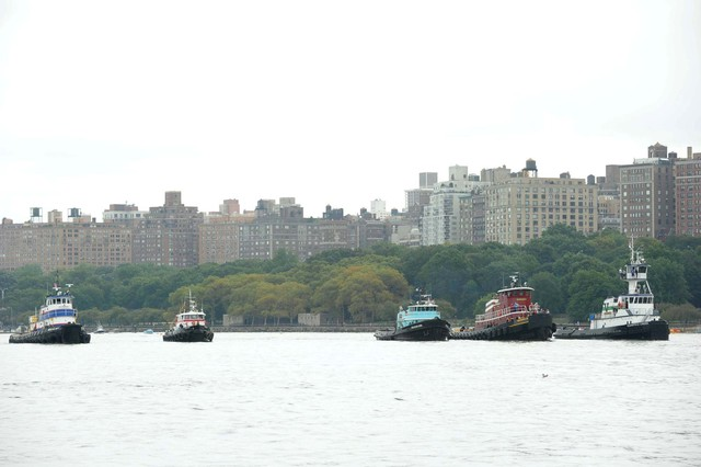Competitors in the Great Northern Tugboat Race cross the Hudson River on September 2, 2012.
