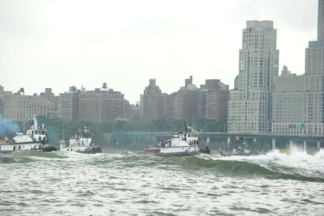 Competitors in the Great Northern Tugboat Race on September 2, 2012 in the Hudson River.