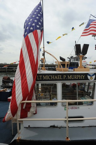 Cheering on the Great Northern Tugboat Race on September 2, 2012 in the Hudson River.