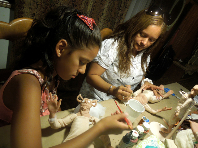Vicky and Jackie Escalona working on their dolls.