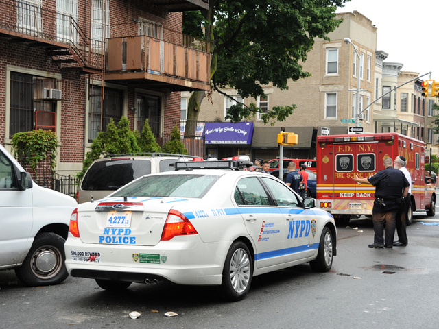 Cops at the scene of an earlier four alarm fire at 1365 Carroll St. in Brooklyn on Monday, Sept. 3, 2012.
