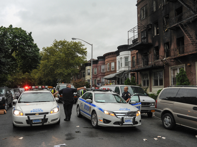 Cops at the scene of an earlier four-alarm fire at 1365 Carroll St. in Brooklyn on Monday Sept. 3, 2012.