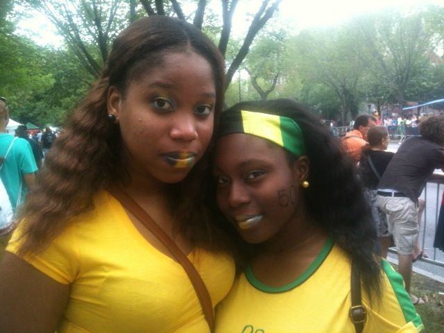 Trishana Hamilton, 16, and Ashley Lewis, 14, came to the parade to represent Jamaica, their lips painted in the colors of the Jamaican flag.