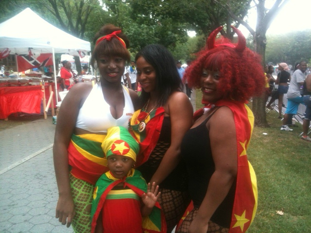 This group of spectators at the parade wore costumes to represent Grenada at the 2012 West Indian Day Parade on Monday, Sept. 3, 2012.