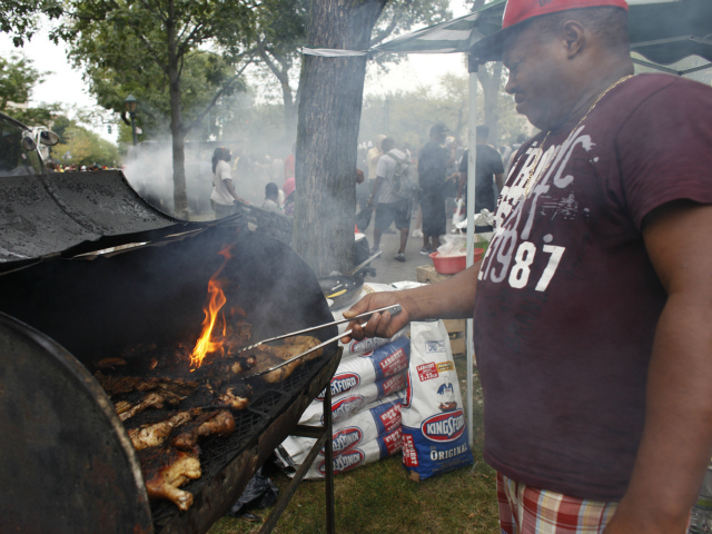Cooking Jerk Chicken at the West Indian-American Day Parade along Eastern Parkway in Brooklyn. Sept. 3, 2012.