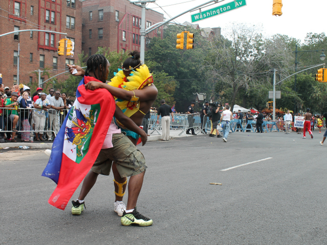 Parade participants dance in the middle of the street during the 2012 West Indian-American Day Parade. Sept. 3, 2012.