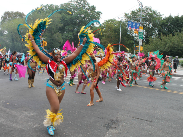 Parade participants wear brightly colored, feathered costumes during the 2012 West Indian-American Day Parade. Sept. 3, 2012.