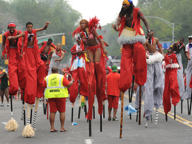Stilt walkers perform for the judges on Eastern Parkway on Monday Sept. 3, 2012.