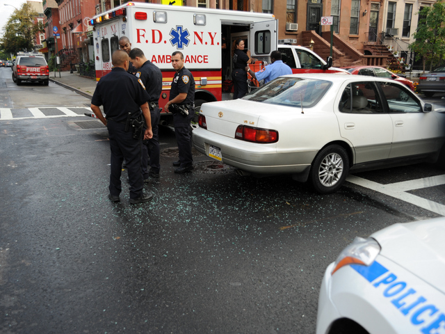 Shattered glass from the crash is seen on the roadway on Tuesday September 4, 2012.