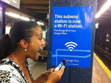 an excited woman using her phone in the subway