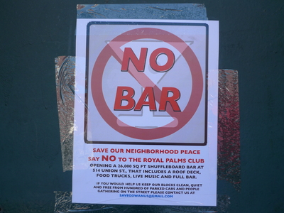 Neighbors along Union Street have posted signs protesting the arrival of the Royal Palms Shuffleboard Club.
