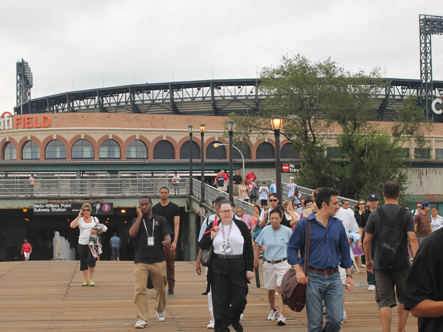 Fans exit the 7 train at Willets Point for the U.S. Open