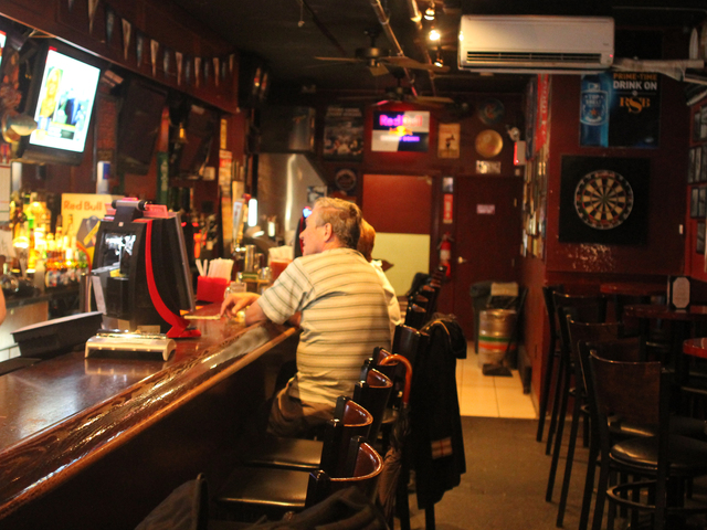 Business is slow at the Roosevelt Sports Bar, despite its location down the street from the U.S. Open.