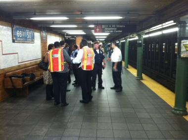 A downtown 1 train clipped a straphanger who was walking on edge of an Upper West Side subway station platform, an MTA spokesman said.