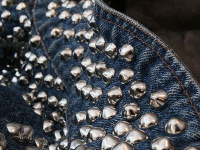 "The stud detailing brings a vintage denim jacket from ""staple to statement,"" according to Sierra Fromberg, the owner of Grey Era Vintage."