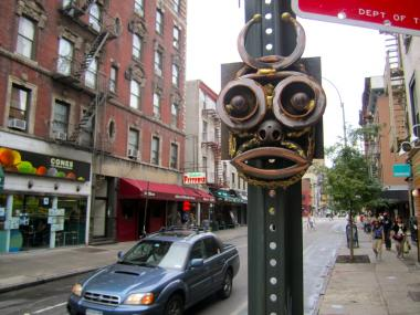 Small steel and bronze sculptures with faces appeared on city parking signs in the West Village in early September 2012.