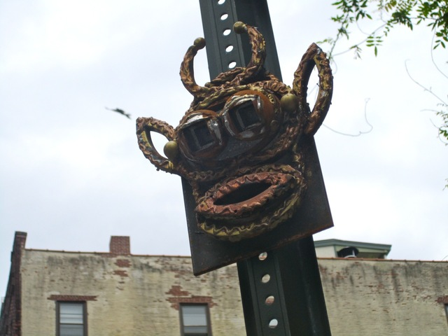 The metal face sculptures are made of steel and bronze, the anonymous artist said.