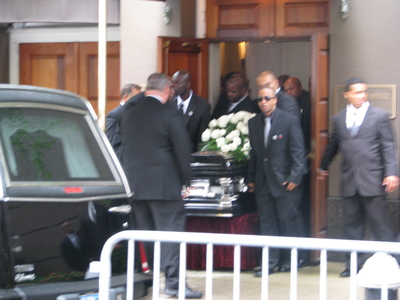 Chris Lighty's casket is brought out of the funeral home.
