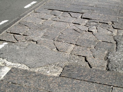 SoHo residents said in September 2012 that they have navigated crumbling cobblestone crosswalks like this one for more than 15 years. The DOT said Sept. 5, 2012 that it plans to repair crosswalks on Mercer Street and Greene Street starting in fall 2012.
