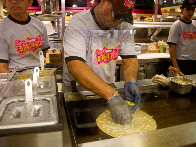 Chefs at Café Spice Dosateria & Lassi Bar at Whole Foods Market in TriBeCa put cheese toppings on a dosa, an Indian crepe.