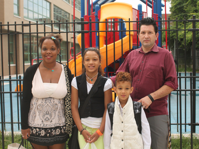 Judy and Andrea Nunez with their children, Kelly and Brian, outside of P.S. 196 Grand Central Parkway in Forest Hills on the first day of school Sept. 6, 2012.
