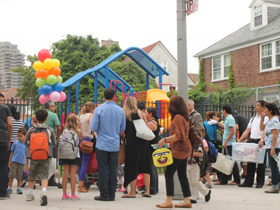 Parents drop their children off at P.S. 196 Grand Central Parkway in Forest Hills on the first day of school Sept. 6, 2012.