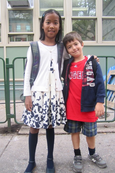 Lydia Cresci, 8, chose a patterned dress for her first day of 4th grade at P.S. 41 in Greenwich Village Sept. 6, 2012. Her brother Nicholas, 6, chose a more casual look.