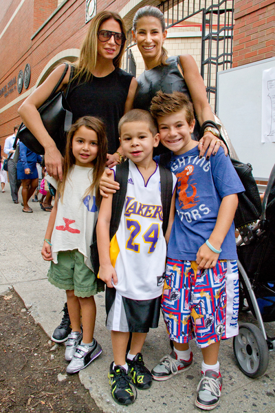 Lori Morgen, 41, (right and back) takes her son Jagger, 7, (far right) to his first day of school September 6, 2012 at P.S. 234 in TriBeCa.