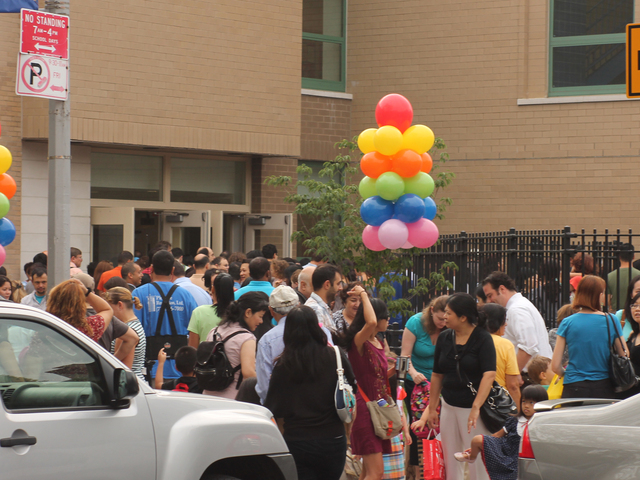Parents wait drop their children off for class at P.S. 196 Grand Central Parkway on Sept. 6, 2012.