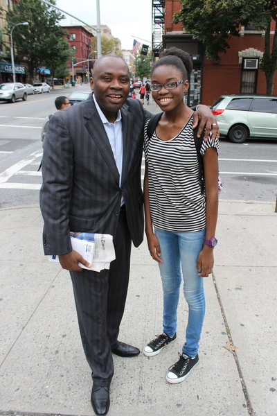 "Dad Confrence Gbaje and daughter Tadafe Gbaje, 12, on their way to Tadafe's first day at Park Slope's M.S. 51. As a seventh grader, Tadafe said she was aiming for an ""older, more stylish"" look, so she wore a shirt from Forever 21."