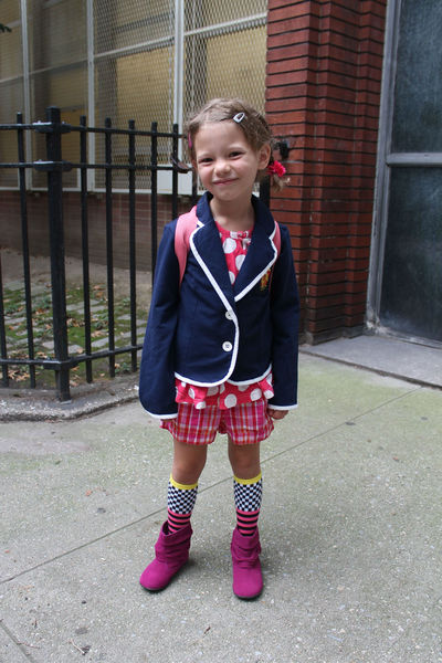 Scarlett, 6, loves colors and picked out her first day of school outfit herself. Her bright pink backpack offered another burst of color in keeping with the neon trend that's still going strong this fall. On her blazer was a patch sewed on by her mom from Hogwart's School — she was headed into P.S. 87.