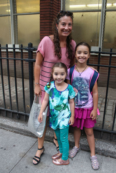 Upper West Sider Tina bought her cotton striped dress from a boutique and was in a hurry to make sure her daughters Emilia and Valentino got to P.S. 87 on time.