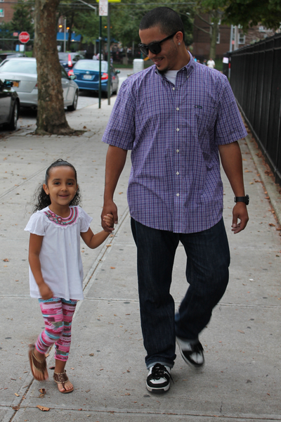 Danny Morales walks his 4-year-old daughter, Skylene, to P.S. 15 in Red Hook. Morales wore a Chap's button-down shirt, Levi's jeans and sunglasses.