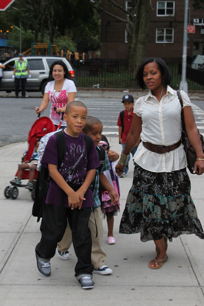 Lucretia Jones walks her children to school at P.S. 15 in Red Hook. She was wearing Liz Claiborne and Ann Taylor, which she described as