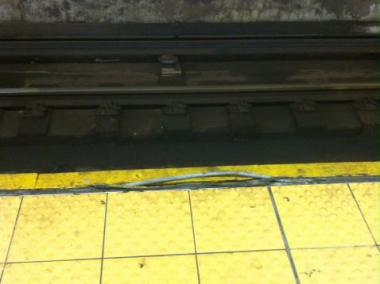 Uprooted structural material on the edge of the subway platform at the 168th Street station along the A train posed a hazard to straphangers going on and off the subway.