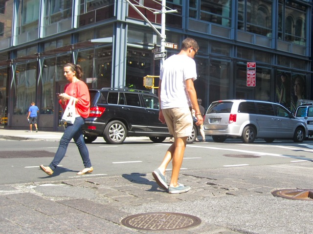 Some pedestrians in SoHo avoid the crumbling crosswalks.
