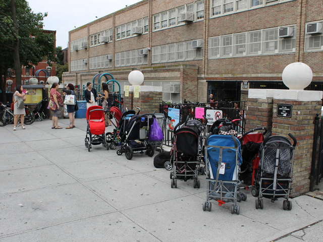 Strollers wait for parents outside P.S. 321 on the first day of school.