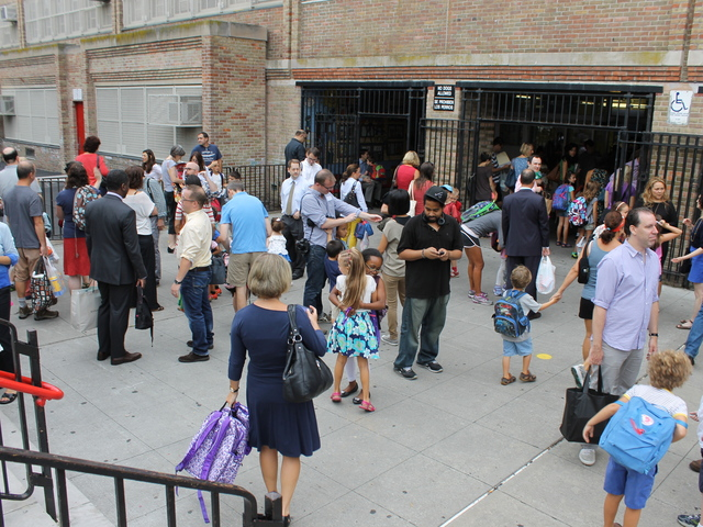 <p>Morning drop-off was full of hugs and smiles as students returned to P.S. 321 in September 2012.</p>