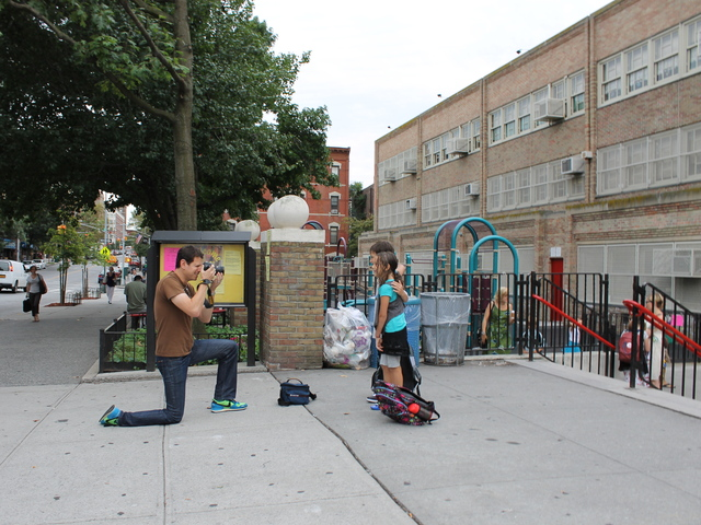 Dad Harold Einstein takes photos of Lux and Izzy Einstein outside P.S. 321 on the first day of school.