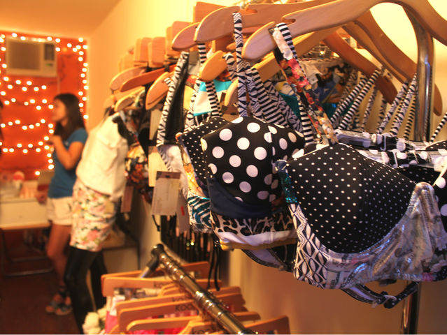 September 6 2012 - Christy Luo designs swimwear for her shop in the DeKalb Market.