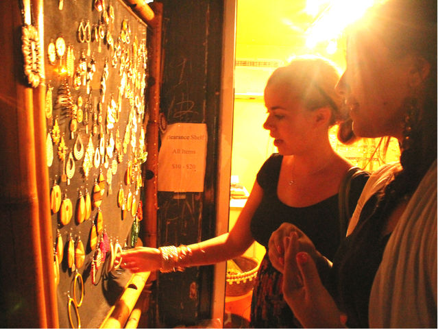 September 6 2012 - Women looked at jewelry designed by Stacey E. Ford for Amaya Designs at DeKalb Market.